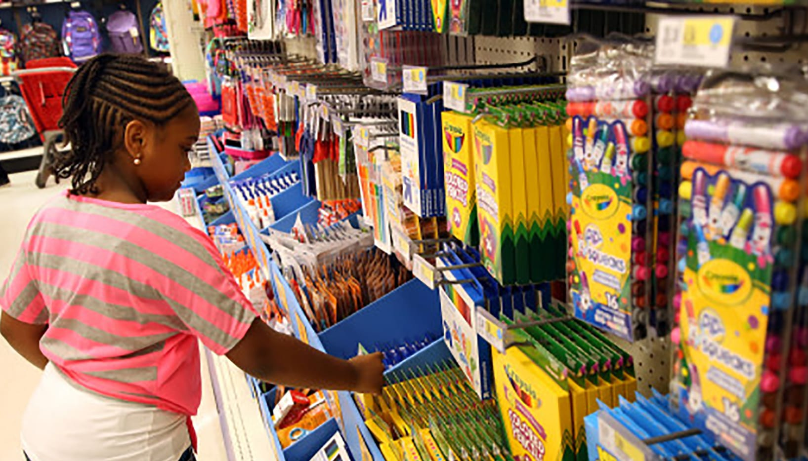 students shopping in store for school supplies