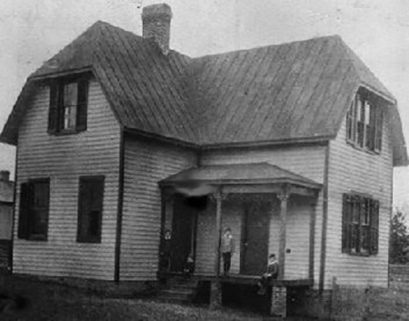 black and white photo of old school house building