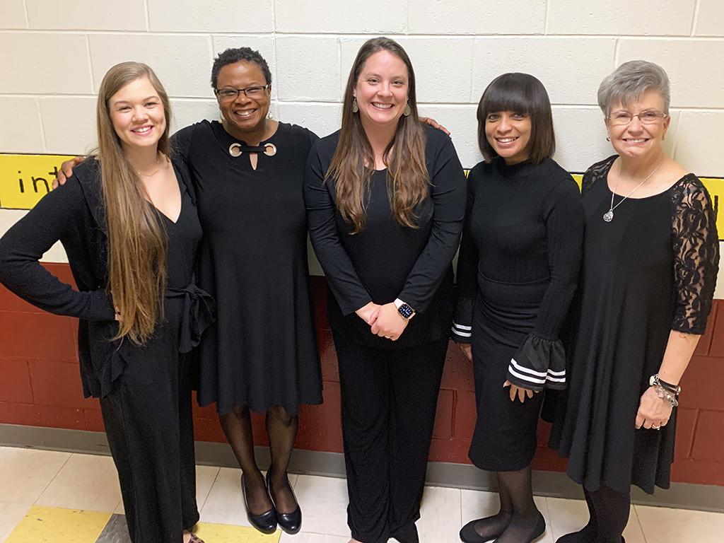 Five female kindergarten teachers pose for a group photo.