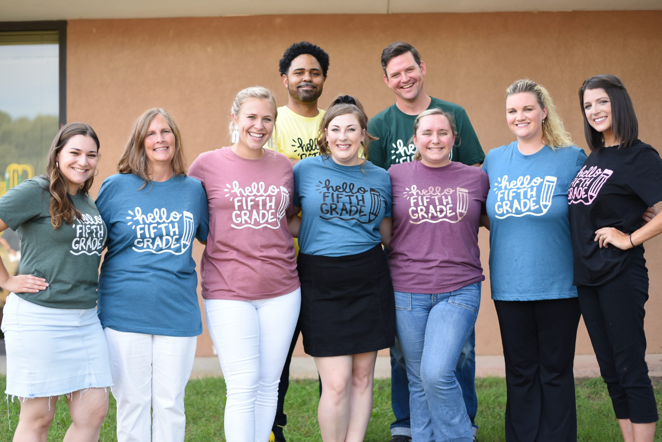Large group of 5th grade teachers pose for a photo.