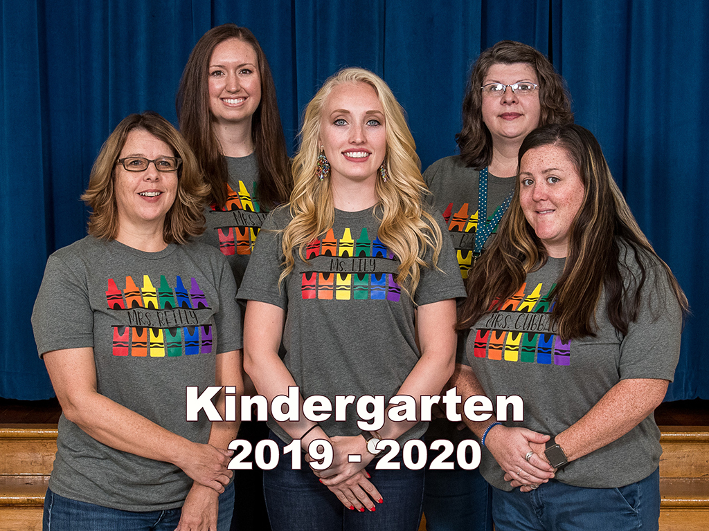 five kindergarten teachers pose in matching t-shirts
