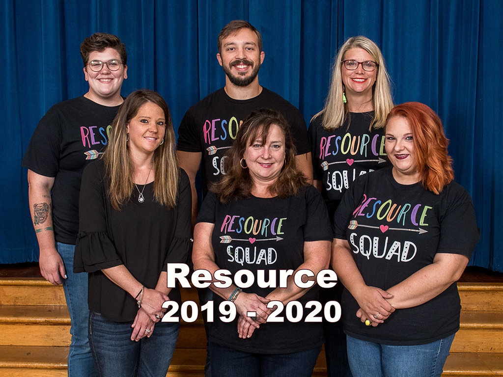 six teachers in matching t-shirts pose for a photo