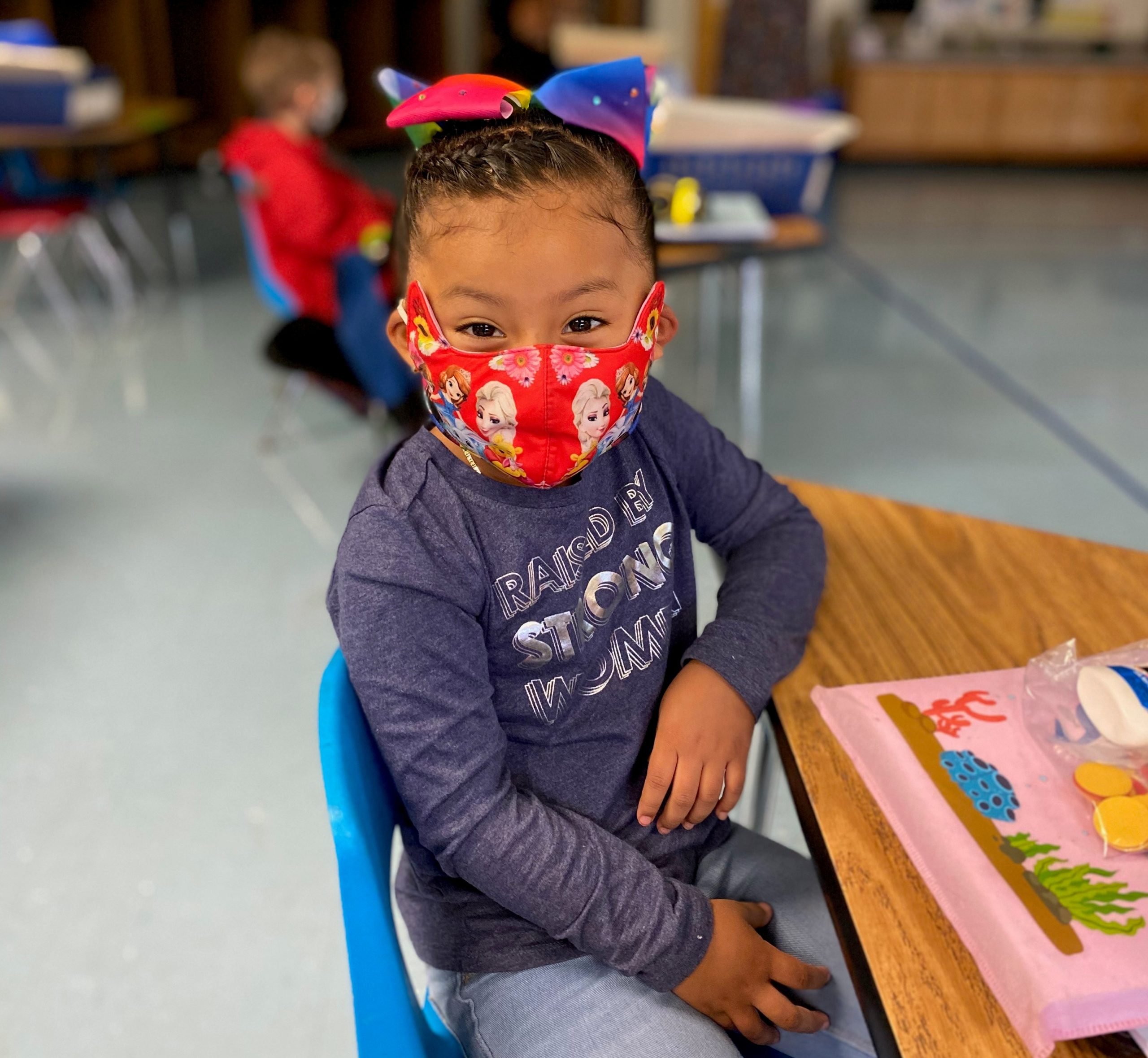 Elementary Student in class wearing a mask