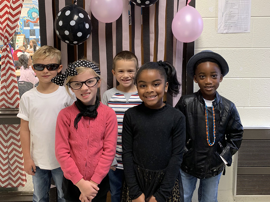 five students dressed like the 50's for the 50th day of school