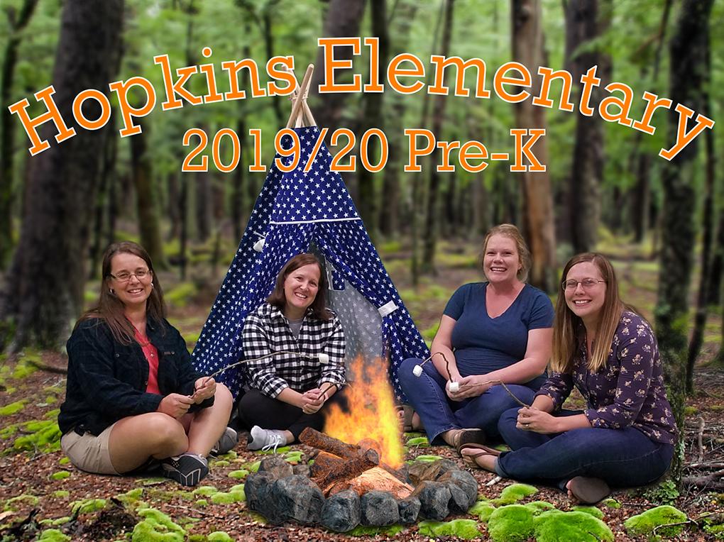 four teachers sit around a bon fire