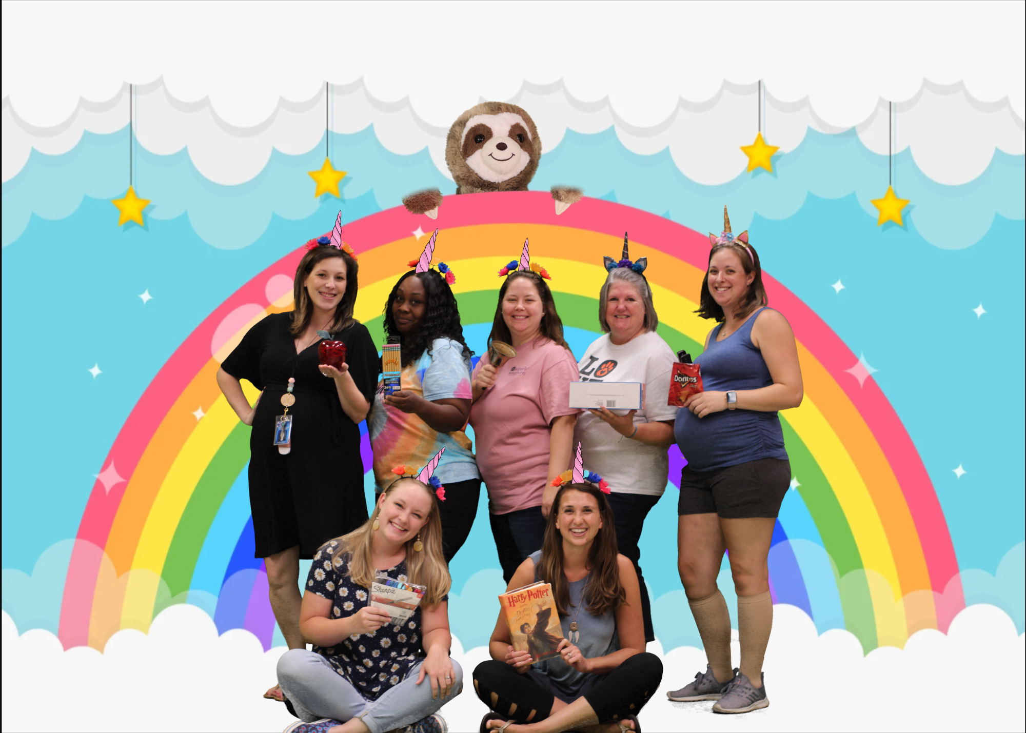 Group of teachers with faux rainbow background.