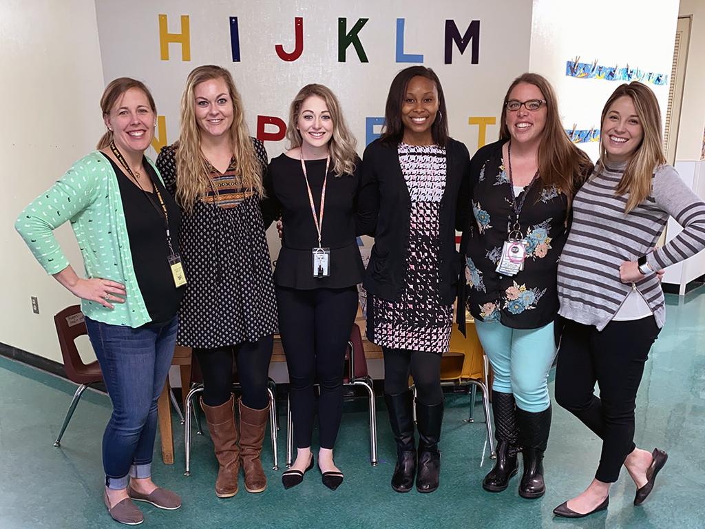 Six female teachers pose for a photo.
