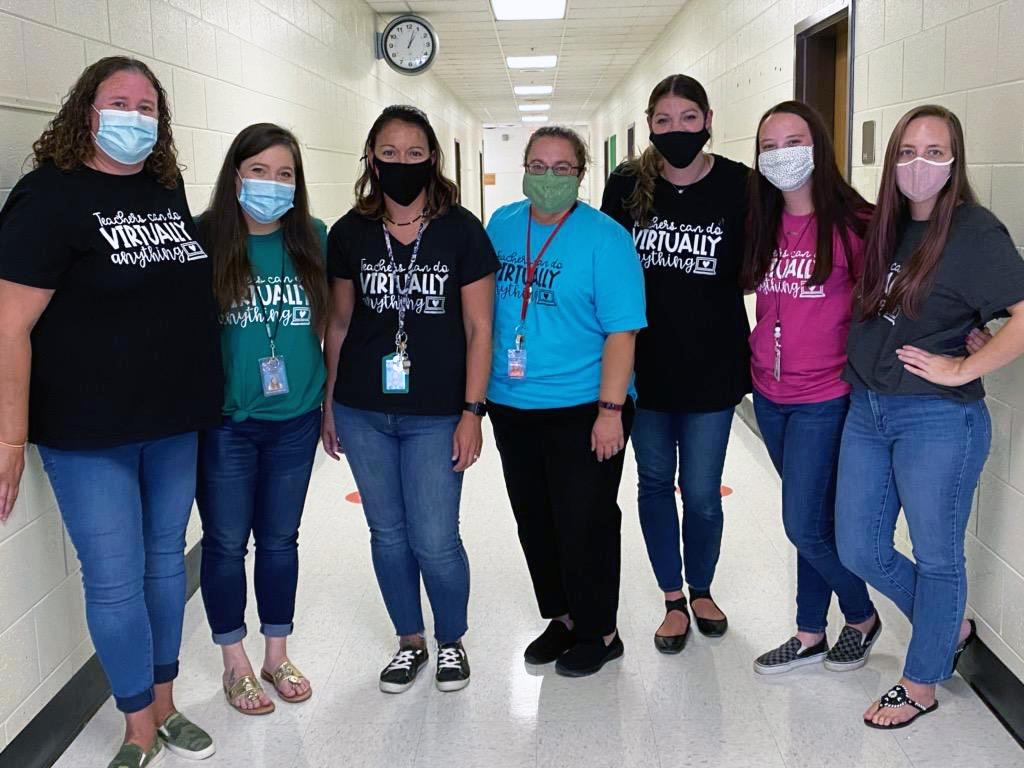 Group photo of seven teachers