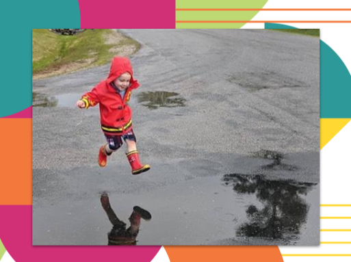 Child playing in a puddle