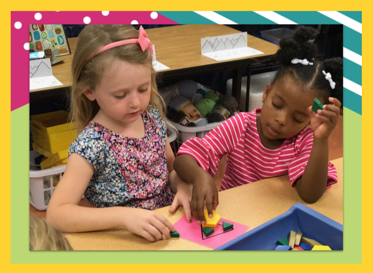 Two school children learning math