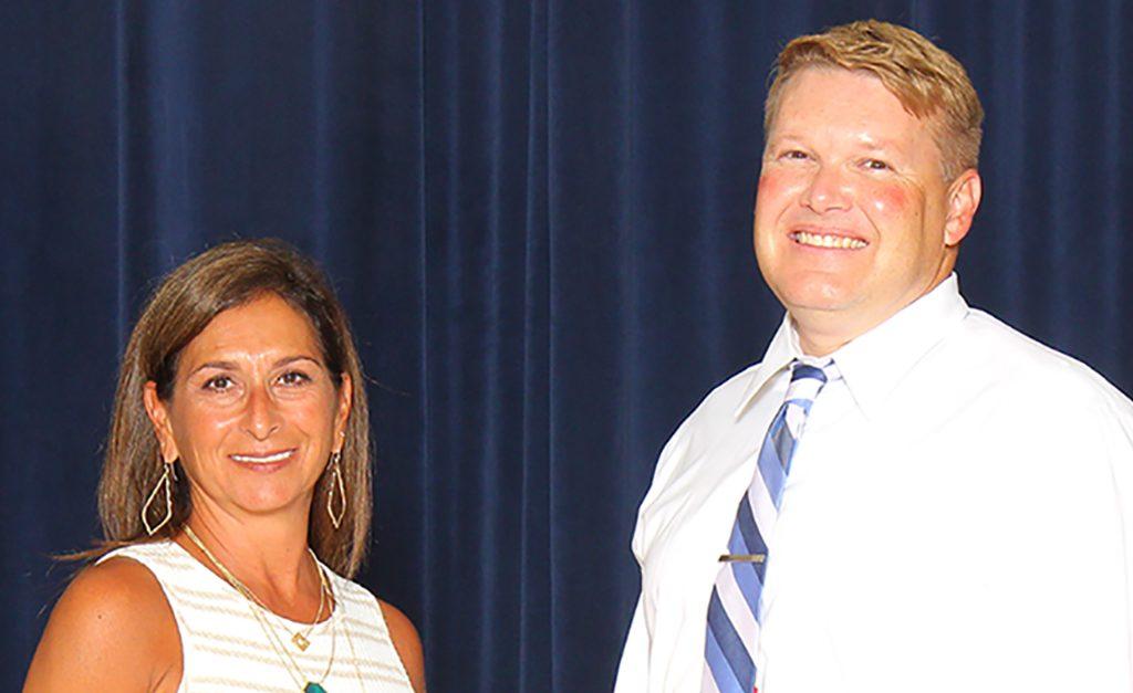 Principal and AP pose for a photo