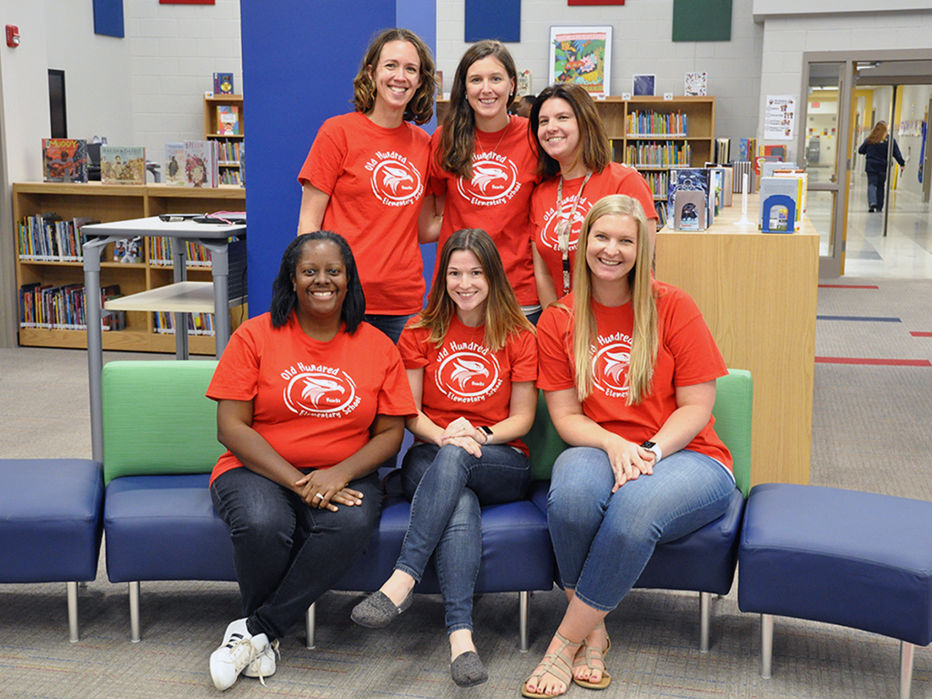 group of six teachers pose for a group photo