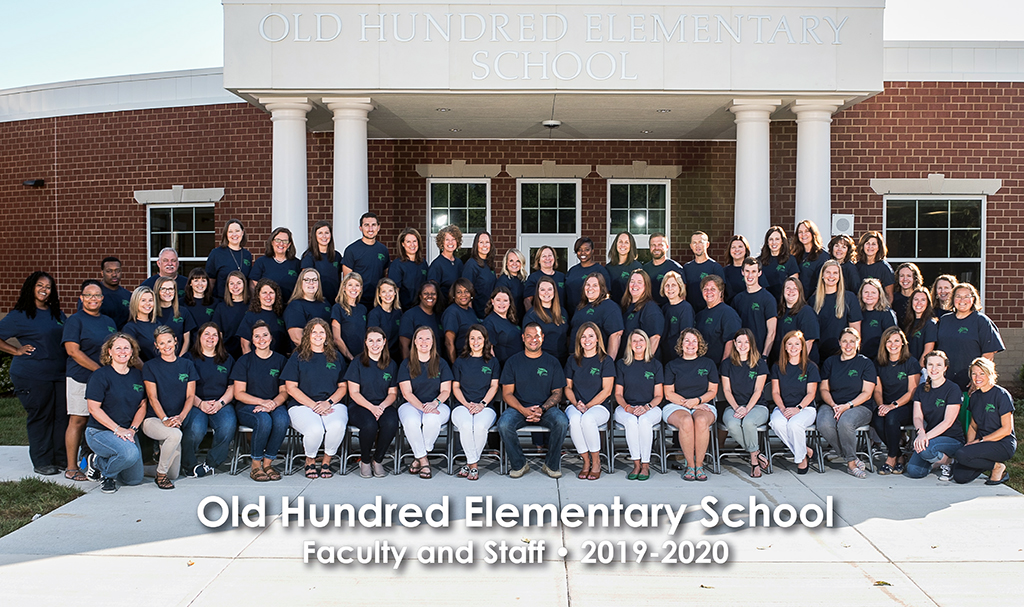 group photo of 2019-20 entire staff in front of building