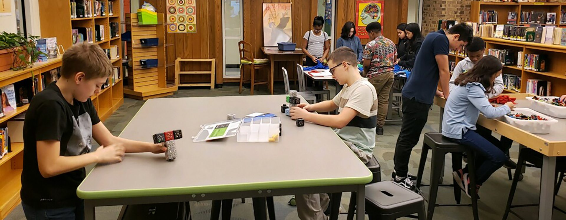 students working at their tables in a classroom.