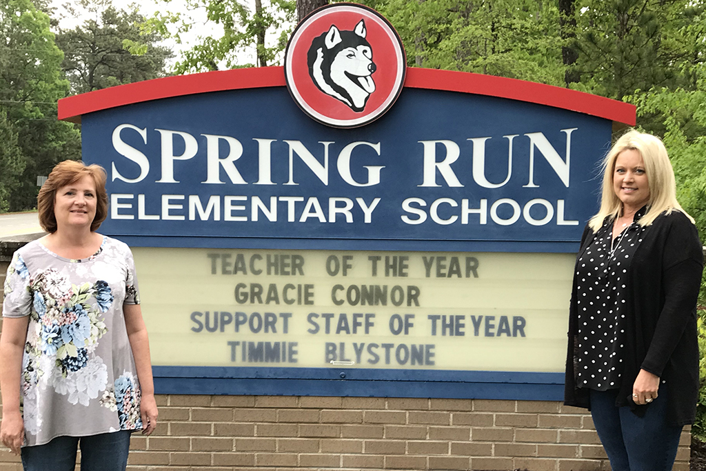 Grace Connor poses in front of school sign announcing her win.