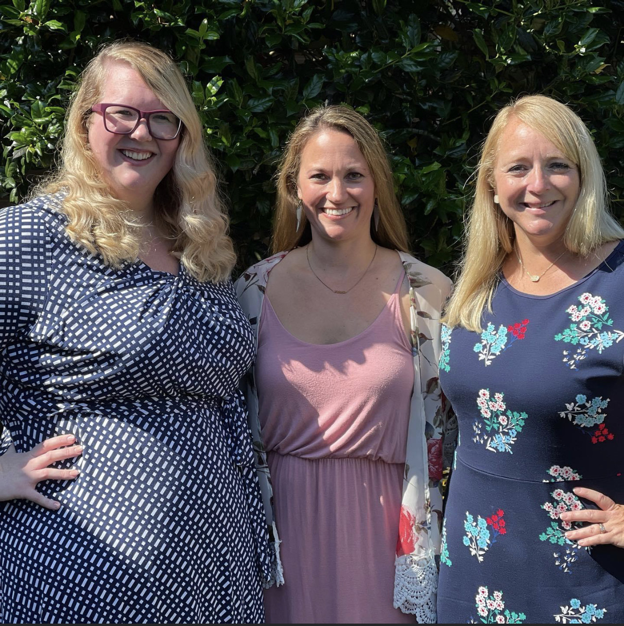 Three female counselors pose for a photo.