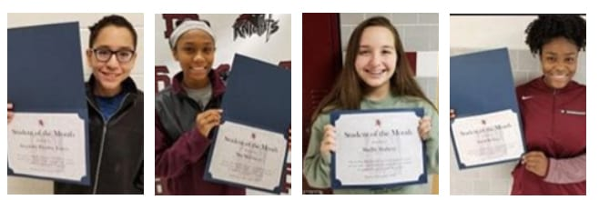 4 students hold up certificates