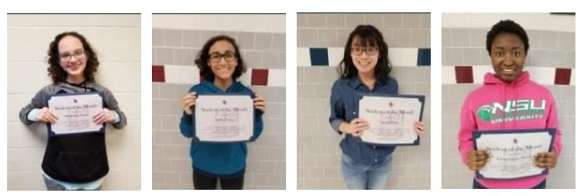 4 students hold up their certificate