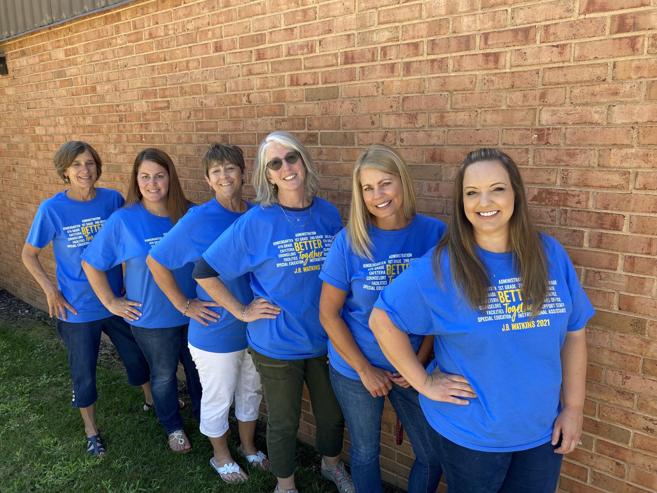 Five teachers lineup for a photo.