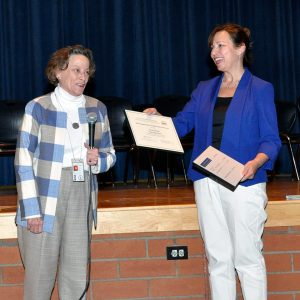 Photo shows Betsy Barton, history specialist for the Virginia Department of Education, presenting award to Nicole Winter (on right) on June 6.
