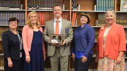 Teachers and Admin celebrate the award