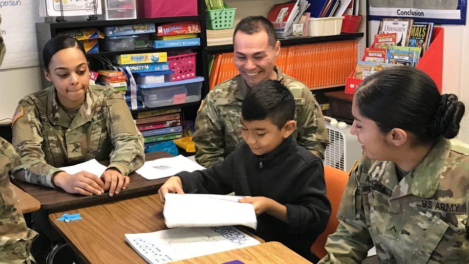 Veterans helping at school