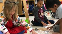 elementary students working on crafts