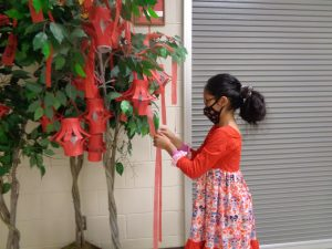Student making a wish during Chinese new year