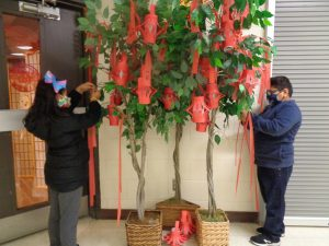 Students making a wish during Chinese new year