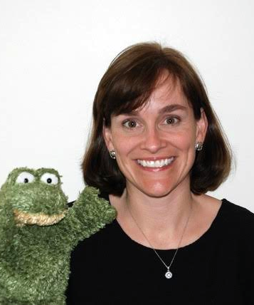 photo of Ms. Weaver holding a frog puppet