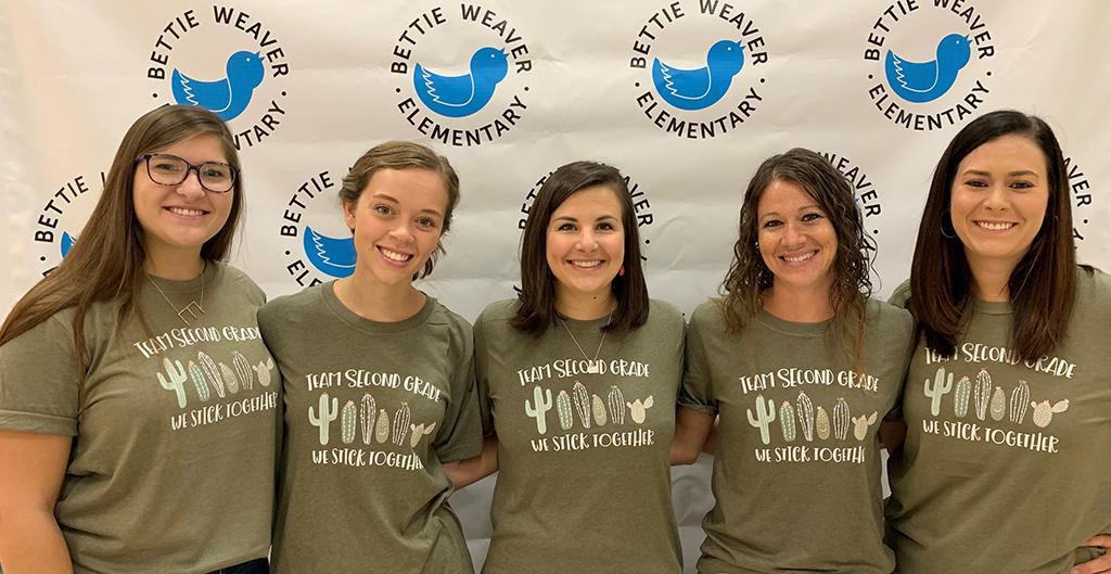 Five female teachers pose for a photo.