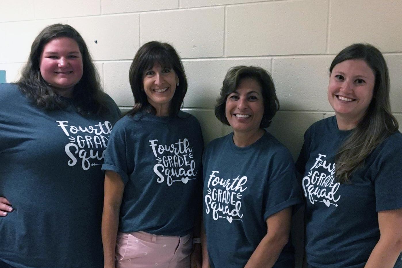 Four female teachers pose for a photo.
