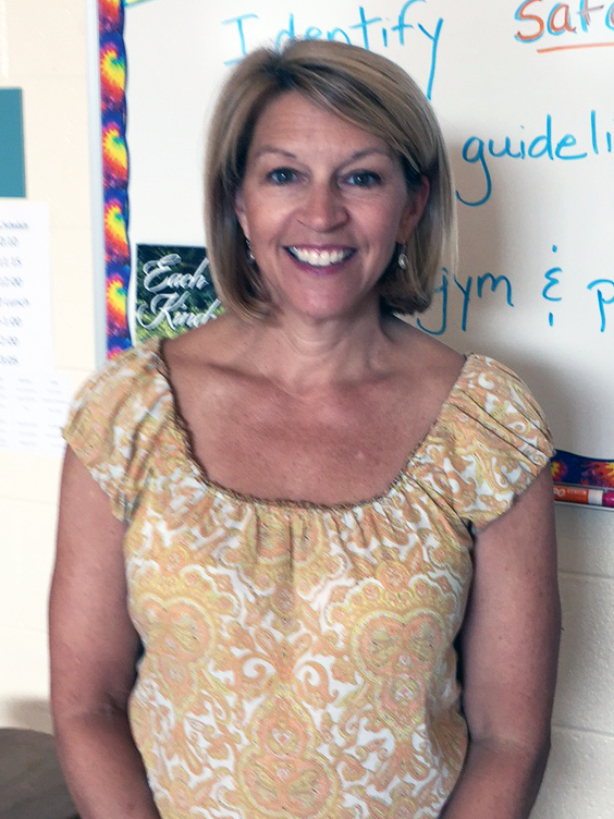 Teacher poses for a photo.